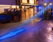 Blue LED Safety Light w/ Arrow Beam Pattern: Showing Beam with Fog in Warehouse