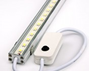 LED linear light fixtures with integrated ON/OFF switch