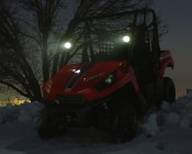 "3.25"" Round 18 Watt LED Mini Auxiliary Work Light installed on UTV driving in the snow"