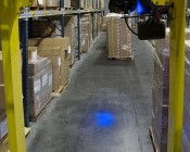 Blue LED Safety Light w/ Square Beam Pattern: Driver's Perspective of Light Shinning on Warehouse Floor