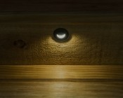 LED Step Lights - Black 40mm Metal Trim with Hood Mini Round Deck / Step Accent Light - 0.5 Watt: Shown Installed On Deck And ON.