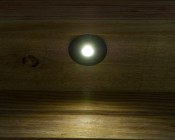 LED Step Lights - Black 70mm Metal Trimmed Mini Round Deck / Step Accent Light - 0.5 Watt: Installed On Deck And Shown ON.