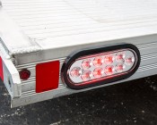 "Oval LED Truck Lights and Trailer Lights with Clear Lens - 6"" LED Brake/Turn/Tail Lights w/ 10 High Flux LEDs - 3-Pin Connector: Turned On Installed in Trailer"