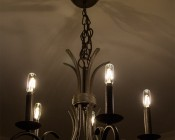 LED Vintage Light Bulb - T8 Shape - Radio Style Candelabra LED Bulb with Filament LED: Shown Installed In Chandelier On And Dimmed.