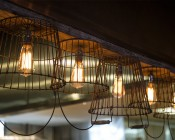 LED Vintage Light Bulb - ST18 Shape - Edison Style Antique Bulb with Filament LED: Shown Installed And On In Vintage Sconce.