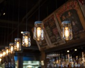 LED Vintage Light Bulb - T14 Shape - Radio Style LED Bulb with Filament LED: Shown Installed In Mason Jar Fixtures And On.