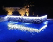 Weatherproof LED Light Strips Accenting Waterfall into Pool