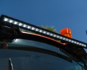"LED Work Light Extension Tab: Shown Installed On Tractor And Extending 50"" Light Bar Mounts."