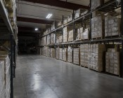 100W LED Linear High Bay Light - 3-Lamp T5HO/5-Lamp T8 Equivalent - 13,600 Lumens - 5000K: Two Lights Installed in Warehouse - Angled View of Light Output