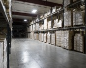 300W LED Linear High Bay Light - 8-Lamp T5HO/14-Lamp T8 Equivalent - 41,400 Lumens - 5000K: Two Lights Installed in Warehouse - Angled View of Light Output