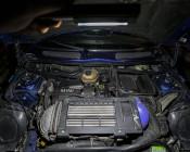 LiL Larry LED Flashlight by NEBO: Shown Lighting Up Car Engine.