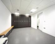 72W LED Panel Light Fixture - 4ft x 2ft: Shown Installed In Locker Room In Natural White.
