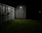 LED Motion Sensor Light - Single Head Security Light - 10W - 730 Lumens: Illuminated On Shed