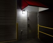 Photocontrol Mini LED Wall Pack - 30W (175W MH Equivalent) - 5500K/4000K - 2,400 Lumens: Installed Outside Warehouse Door