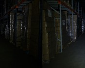 6001 NEBO Workbrite LED Work Light: Shown Illuminating Warehouse Aisle With The Head Beam (Left) And Face Beam (Right)