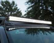 """40"""" Off Road LED Light Bar - 120W: Shown Installed On SUV Roof And On."""