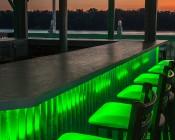 High Density RGB LED Strip Light - Flexible Custom Length LED Tape Light - 18 SMDs/ft. - 3 Chip SMD LED 5050: Shown Installed Under Bar And On In Green.