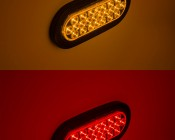 """Oval LED Truck and Trailer Light - 6"""" LED Brake/Turn/Tail Lights w/ 24 High Flux LEDs - 3-Pin Connector: Showing Color Turned On with Rubber Grommet (not included)"""