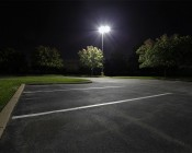 LED Corn Light - 500W Equivalent HID Conversion - E39/E40 Mogul Base: Multiple Bulbs Shown Retrofitted In Existing Parking Lot Lighting Fixtures.