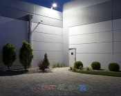 LED Dusk to Dawn Security Light w/ Mast Arm - 50W - Natural White: Shown Installed On Building Roof (Approximately 25') Illuminating Garden In Natural White.