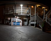 LED Dusk to Dawn Security Light w/ Mast Arm - 50W - Natural White: Shown Installed Over Parking Lot In Natural White.