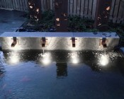 LED Underwater Pool Lights and Pond Lights - Single Lens - 60W: Shown As Up Lighting In Small Pond/Water Feature.