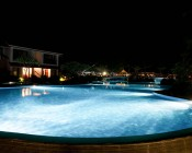 LED Underwater Pool Lights and Pond Lights - Triple Lens - 180W: Shown Installed In Swimming Pool In White.
