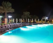 LED Underwater Pool Lights and Pond Lights - Triple Lens - 180W: Shown Installed In Resort Pool In White.