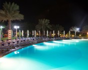 LED Underwater Pool Lights and Pond Lights - Double Lens - 120W: Shown Installed In Resort Pool In White.
