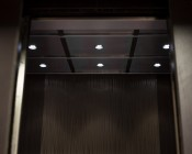 Recessed LED Puck Lights - 12 LED - 20 Watt Equivalent: Shown Installed In Elevator Ceiling In Cool White.