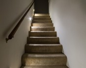 ReadyBright Wireless Power Outage Stair Light: Installed On Wall Looking Up Stairs