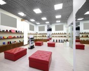72W LED Panel Light Fixture - 4ft x 2ft: Shown Installed In Shoe Store In Cool White.