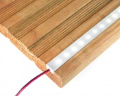 Slim Aluminum Profile Housing for LED Strip Lights: Shown Installed In Routed Groove On Step.