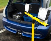 Dual Head Portable LED Work Lights with Tripod Stand - 3,600 Lumens: Shown Plugged Into Car Power Receptacle And On.
