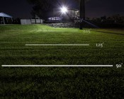 150 Watt High Power LED Flood Light Fixture in Natural White: Shown Illuminating Field From Approximately 30' Above Ground Level.