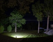 150 Watt High Power LED Flood Light Fixture in Natural White: Shown At Ground Level In Large Field.