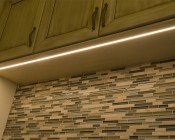 Surface Mount Anodized Aluminum LED Profile Housing - MICRO-ALU: Channel Shown Installed Under Custom Cabinets In Routed Groove.