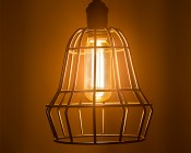 LED Vintage Light Bulb - Gold Tint T14 Shape - Radio Style LED Bulb with Filament LED: Installed in Decorative Cage Fixture