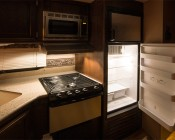 T22 LED Replacement Bulb for WB36X10003 and other Microwave Light Bulbs: Shown Installed In Mini Fridge And Range Hood.