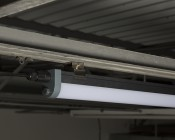 40W Linkable Linear LED Strip Light Fixture - Industrial LED Light - 4' Long - 4,000 Lumens: Installed Close Up View On Clamps