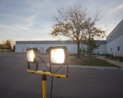 Portable Work Light Tripod Stand w/ Flat T-Bar: Shown With High Voltage 30 Watt Warm White Flood Lights Installed (Flood Lights Sold Separately).
