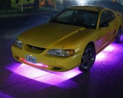 Under Glow LED Lighting Kit - Multi-Strip Remote Activated RGB Color Changing Kit: Shown Installed On Mustang And On In Magenta.