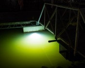 LED Underwater Boat Lights and Dock Lights - Triple Lens - 180W: Shown Installed On Dock In White.  Green Tint Is From Mississippi River Water.
