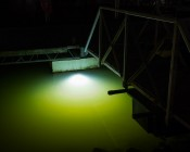 LED Underwater Boat Lights and Dock Lights - Double Lens - 120W: Shown Installed On Dock In White.  Green Tint Is From Mississippi River Water.