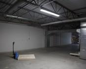 52W Vapor Proof Light Fixture w/ Optional Motion Sensor - Industrial LED Light - 4' Long - 6,760 Lumens - 5,000K: Light Installed In Work Space