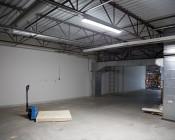 65W Vapor Proof Light Fixture w/ Optional Motion Sensor - Industrial LED Light - 4' Long - 8,190 Lumens - 5,000K: Illuminating Work Space