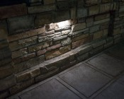 "LED Hardscape Lighting - 8""  Deck / Step and Retaining Wall Lights w/ Mounting Plates: Shown In Natural White In Wall."