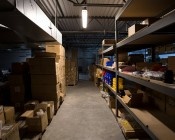 T8 LED Vapor Proof Light Fixture for 2 LED T8 Tubes - Industrial LED Light - 4' Long:  Shown Installed In Warehouse Aisle From Approximately 12' In Warm White.