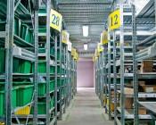 60W Vapor Tight Light Fixture - Industrial LED Light - 4' Long: Shown Illuminating Warehouse Aisle.