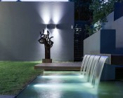 LED Underwater Pool Lights and Pond Lights - Double Lens - 120W: Shown Installed In Water Feature In White.